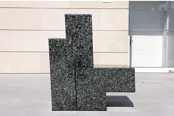 Scott Burton, Two-Part Chair, 1986, Lake Superior Green granite, 40 x 23 x 36 in. (101.6 x 58.4 x 91.4 cm), installation view, Art Institute of Chicago (artwork © 2014 Estate of Scott Burton/Artists Rights Society (ARS), New York)