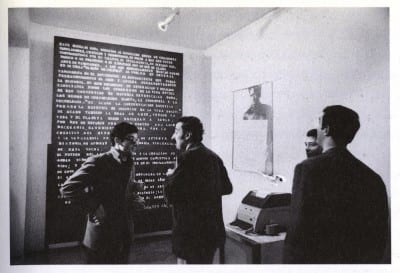 Roberto Jacoby, Mensaje en el Di Tella(Message in the Di Tella), 1968,  message board and lettering, photograph, and telex machine, dimensions variable, installation view, Instituto Torcuato di Tella, Experiencias '68, 1968 (artwork © Robert Jacoby; photograph provided by the artist)
