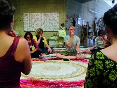 Christian Nagler, Yoga for Adjuncts, 2014, at the Valuing Labor in the Arts Practicum, UC Berkeley Art Museum, April 19, 2014 (photographs © Megan Hoetger, provided by the artist).  Rug: Fritz Haeg, Domestic Integrity Field, 2012–14, crocheted and spirally stitched rug created from local textiles by volunteers, on view January 29–June 1, 2014 (artwork © Fritz Haeg).