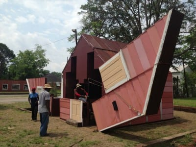 Matthew Mazzotta, Open House: A Transforming Theater for York, Alabama, 2013, Coleman Center for the Arts,York, Alabama (artwork © Matthew Mazzota; photograph provided by Coleman Center for the Arts) The artist worked with the people of York to transform an abandoned home. When its walls and roof are folded out, it becomes an open-air theater that seats one hundred for performances and film showings.