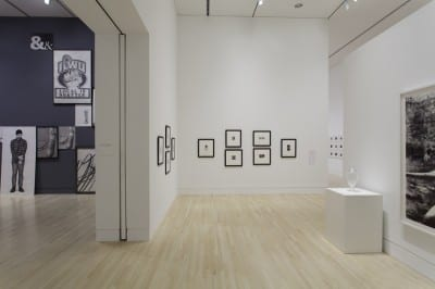 Graphite, installation view showing the work of Karl Haendel (left) and Robert Longo (right) on opposite sides of the same wall, Indianapolis Museum of Art, Indianapolis, Indiana, December 7, 2012–June 2, 2013 (artwork © Karl Haendel; artwork © Robert Longo; photograph provided by Indianapolis Museum of Art)