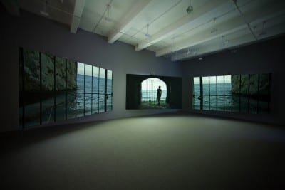 Isaac Julien, Western Union: Small Boats, 2007, three-screen projection, 35mm color film, DVD/HD transfer, 5.1 SR sound, 18 min. 22 sec., edition of 5, installation view, Metro Pictures, New York, 2007 (artwork © Isaac Julien; photograph provided by Metro Pictures, New York)