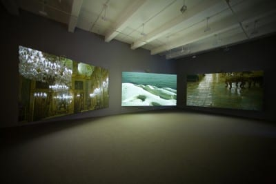 Isaac Julien, Western Union: Small Boats, 2007, three-screen projection, 35mm color film, DVD/HD transfer, 5.1 SR sound, 18 min. 22 sec., edition of 5, installation views, Metro Pictures, New York, 2007 (artwork © Isaac Julien; photographs provided by Metro Pictures, New York)