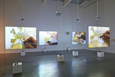 Bouchra Khalili, The Mapping Journey Project, 2008–11, 8 videos, sound, 41 min., installation view, New Museum, New York, 2014 (artwork © Bouchra Khalili; photograph © Benoit Pailley, provided by Galerie Polaris, Paris)