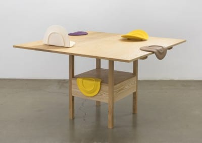 Shana Lutker, As Many Versions as Witnesses, no. 1, 2015, wood (ash), table position: 29 x 51 x 51 in, (73.6 x 129.5 x 129.5 cm), chair position: 64 x 51 x 21 in. (162.5 x 129.5 x 53.3 cm) and Shana Lutker, Ambassadors or Poets, 2015, ceramic, dimensions variable (artworks © Shana Lutker; photograph by Robert Wedermeyer)