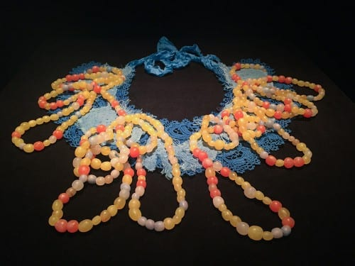 Anna Dumitriu, Engineered Antibody, 2015–2016, twenty-one amino acids, polymer clay, Coomassie Brilliant Blue dye, jewellery wire, cotton calico, vintage tatted linen lace, silk, and embroidery, based on research by Xiang Li (Liu Lab, University of California, Irvine) (artwork © Anna Dumitriu; photograph provided by Beall Center for Art + Technology, University of California, Irvine)