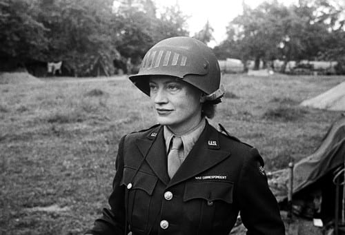 Unknown photographer, Lee Miller in steel helmet specially designed for using a camera, Normandy, France 1944, black-and-white photograph (photograph © The Penrose Collection, England 2016, all rights reserved, www.leemiller.co.uk)