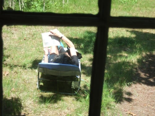 Dore Ashton reading in her garden, Springs, Long Island, New York, summer 2011 (photograph © Madeline Djerejian)