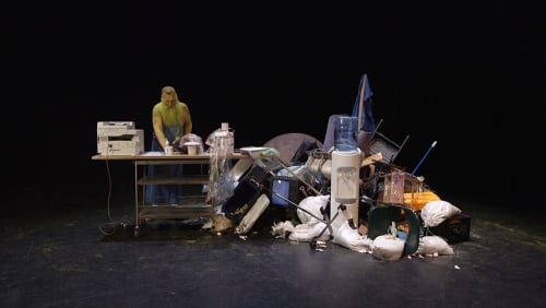 Nayland Blake is Aunt Be/e who performs as re/productive labor. In this scene, she operates a Xerox machine, making copies of objects that have been scavenged from the junk pile that her work station is built from. A.K. Burns, video still from A Smeary Spot, 2015, four-channel video installation, HD color, six-channel sound, TRT 53:13 (artwork © A.K. Burns; image provided by the artist, Callicoon Fine Arts, NY, and Michel Rein Gallery, Paris/Brussels)