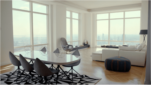 In this screenshot from the McCoys' video, we see the carefully staged Trump World Tower apartment with the skyline of Long Island City visible through the large windows.