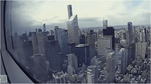 A fish-eye image of Midtown Manhattan, captured by one of the security cameras embedded within the apartment.