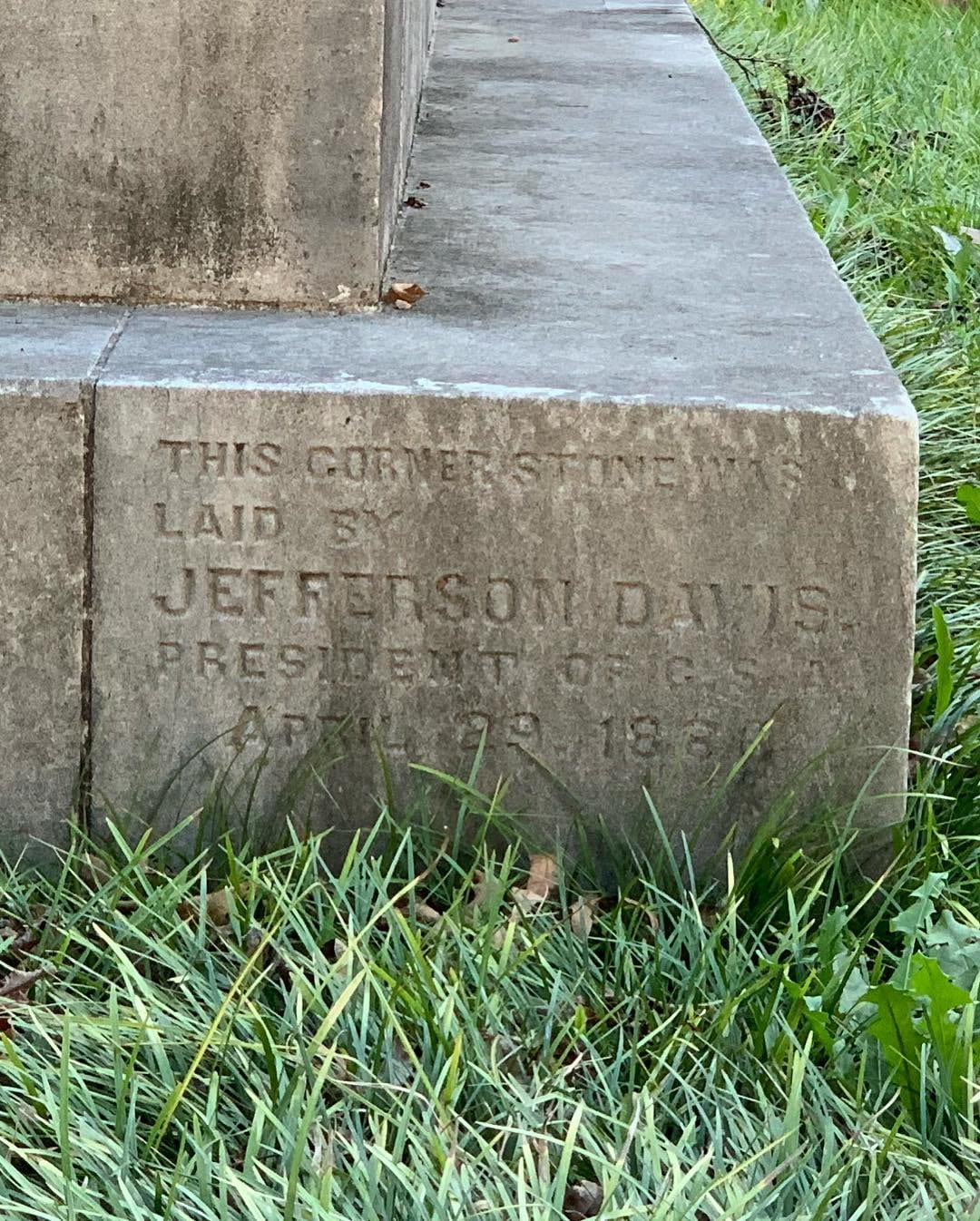 "Detail showing inscription which reads ""the cornerstone laid by Jefferson Davis 1886"""