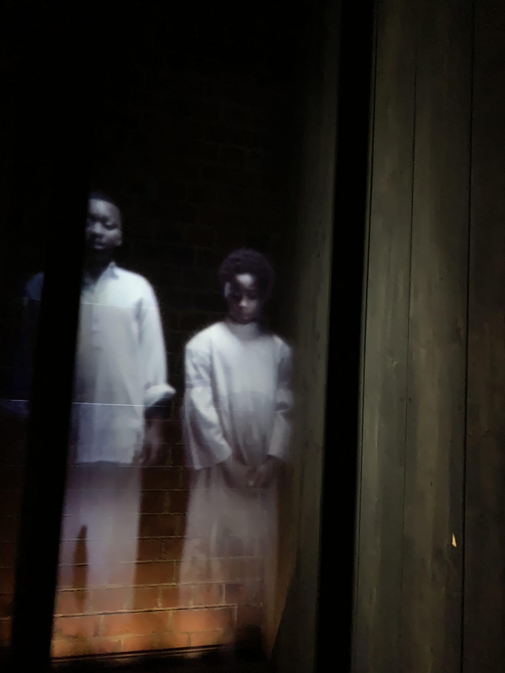 opening installations of holograms with voices speaking accounts of slaves in holding cells before auction