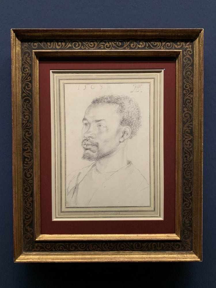 chalk drawing of a black man with a goatee in three quarters view