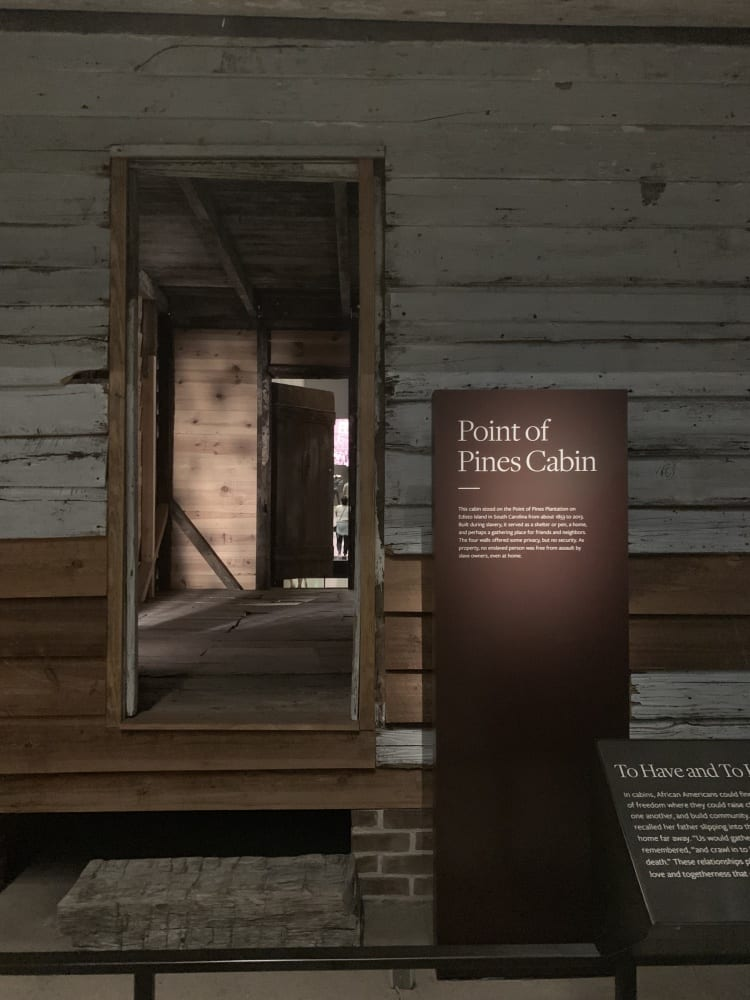 Looking into a small wooden cabin made for slaves