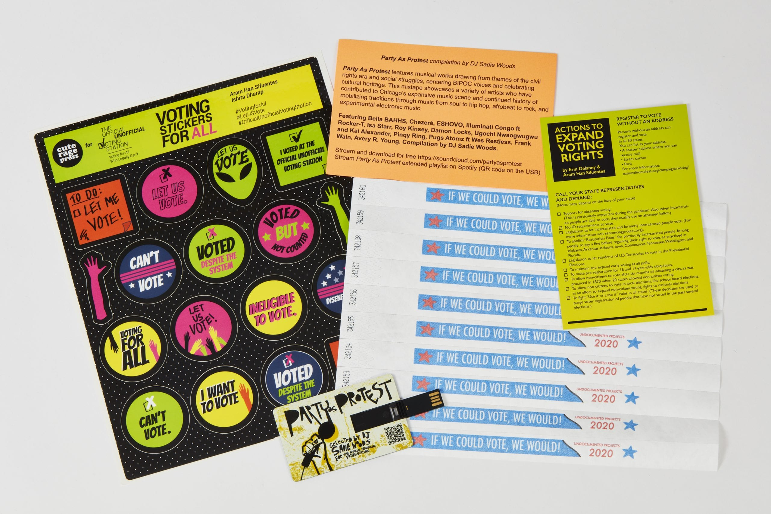 "Colorful branded stickers and wristbands, a USB stick with music, and ""Expand Voting Rights"" flyers"