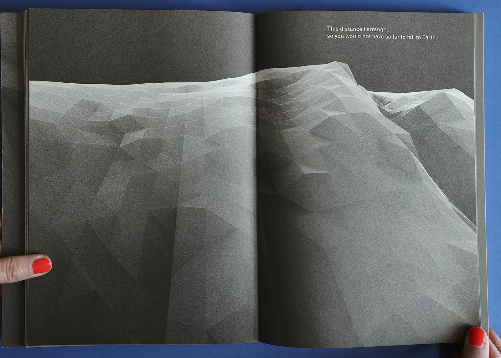 """Open-book spread of Imaginary Explosions, page 35. Above black-and-white graphic of mountain topography, text reads, """"This distance I arranged so you would not have so far to fall to Earth."""""""