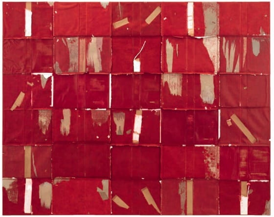 A grid of deep-red, torn, equal-sized flattened book covers stitched together, 5 across by 6 down.
