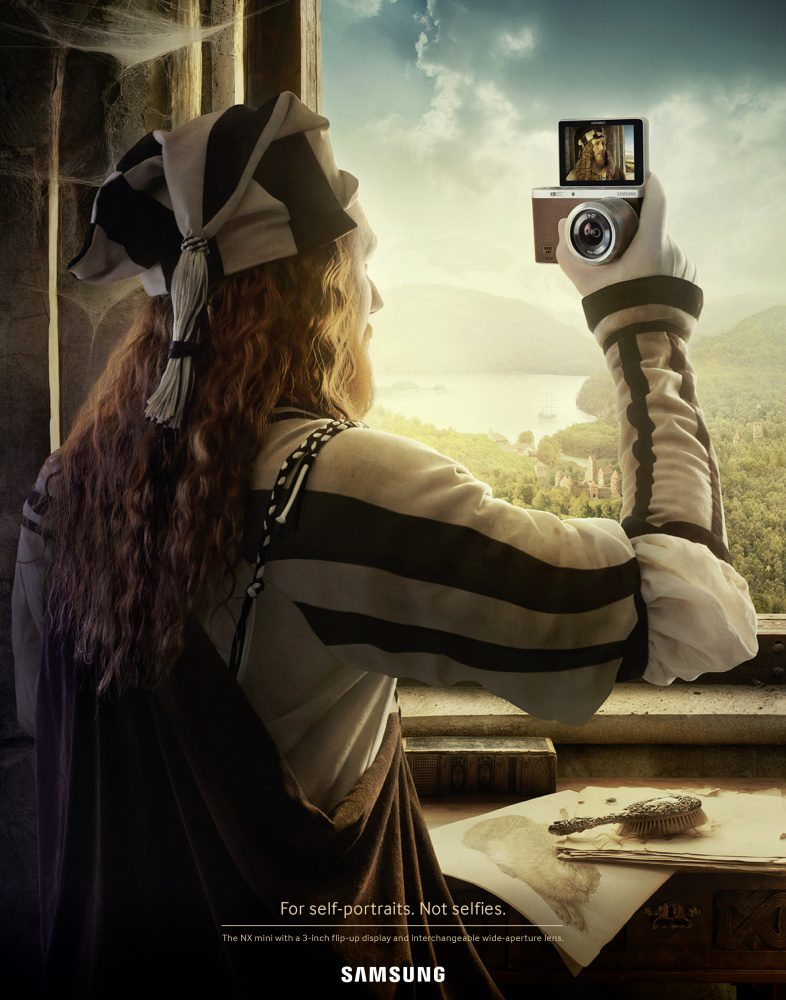 The Leo Burnett Advertising Agency re-created a Dürer self-portrait. In this version, however, the viewer sees Dürer from behind holding up a Samsung NX Mini Camera. In the camera's digital screen, we see the famous self-portrait of Dürer that is now in the Prado Museum.
