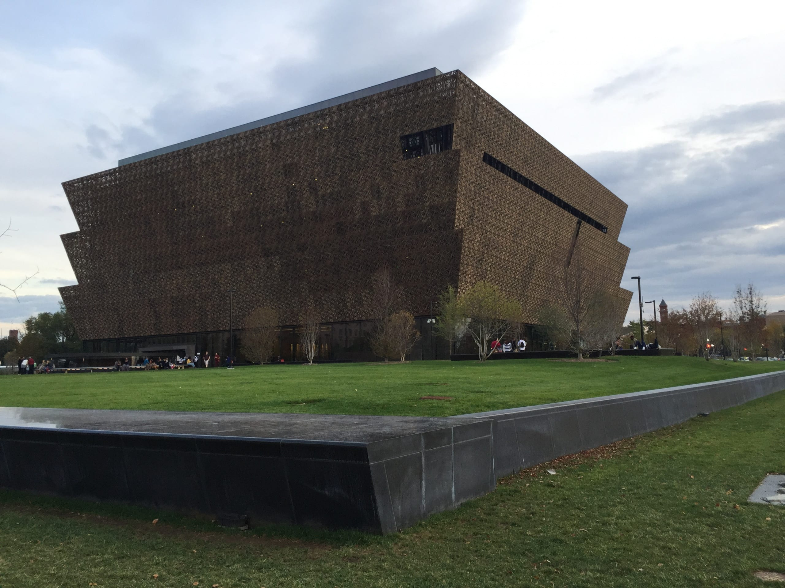 View of the NMAAHC building , showing the metal screen cladding of the exterior