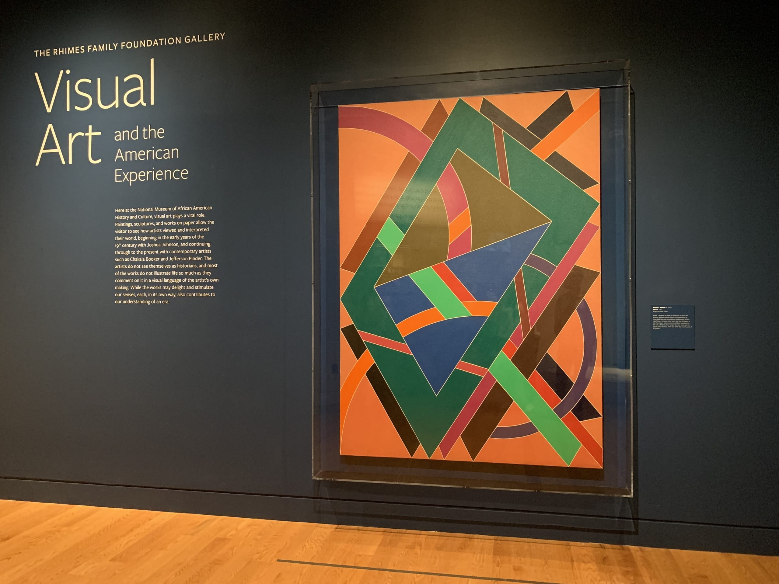 Galleries of Painting and Sculpture: a bright abstract canvas by William T. Williams against a deep blue wall