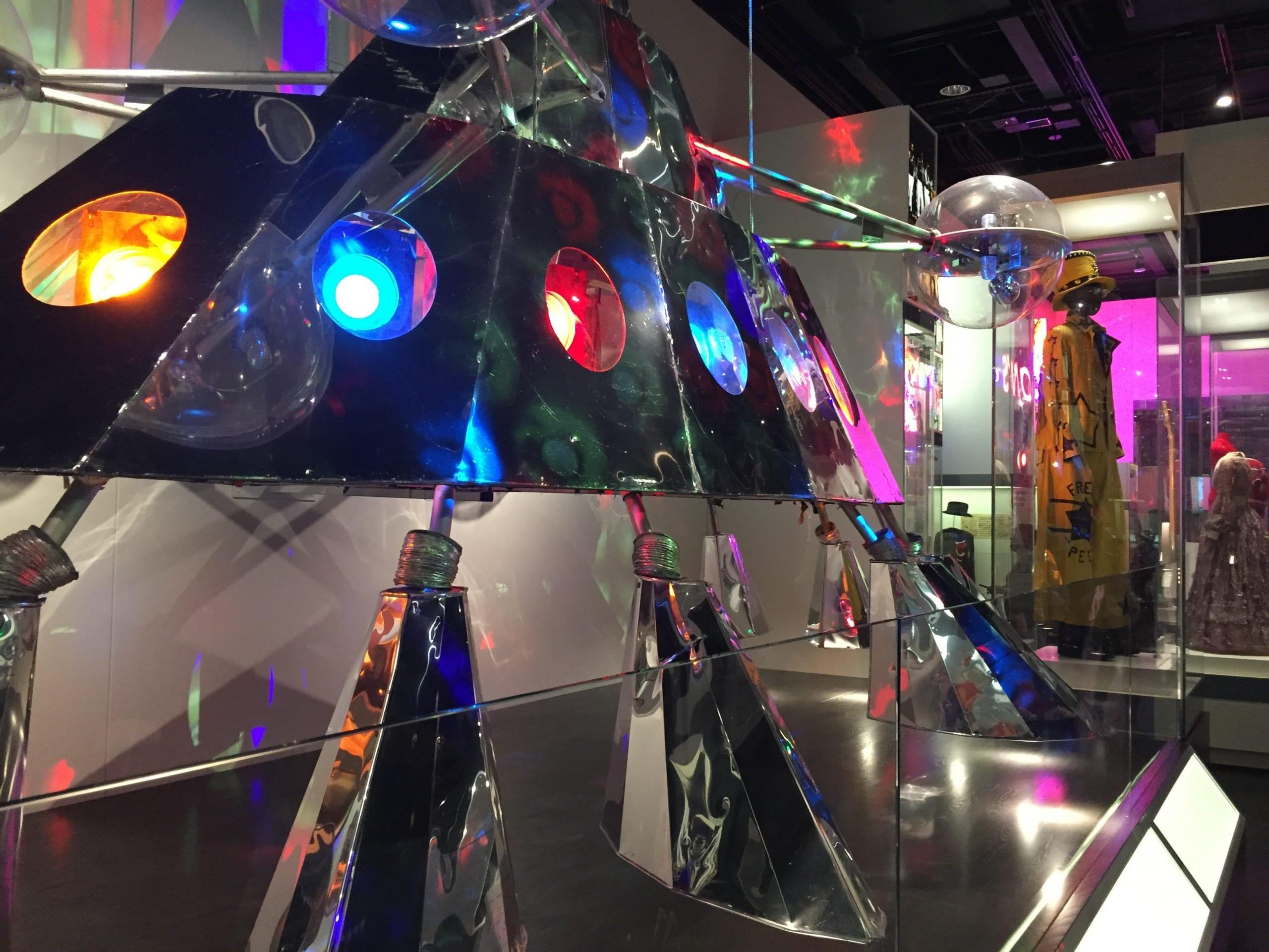 metal space ship with flourescent lights on a platform