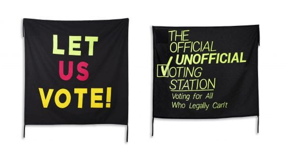 "One banner says ""Let Us Vote!"" in bold, colorful neon letters on a black background; next to it, another banner says ""The Official Unofficial Voting Station: Voting for All Who Legally Can't"" in neon green on black"