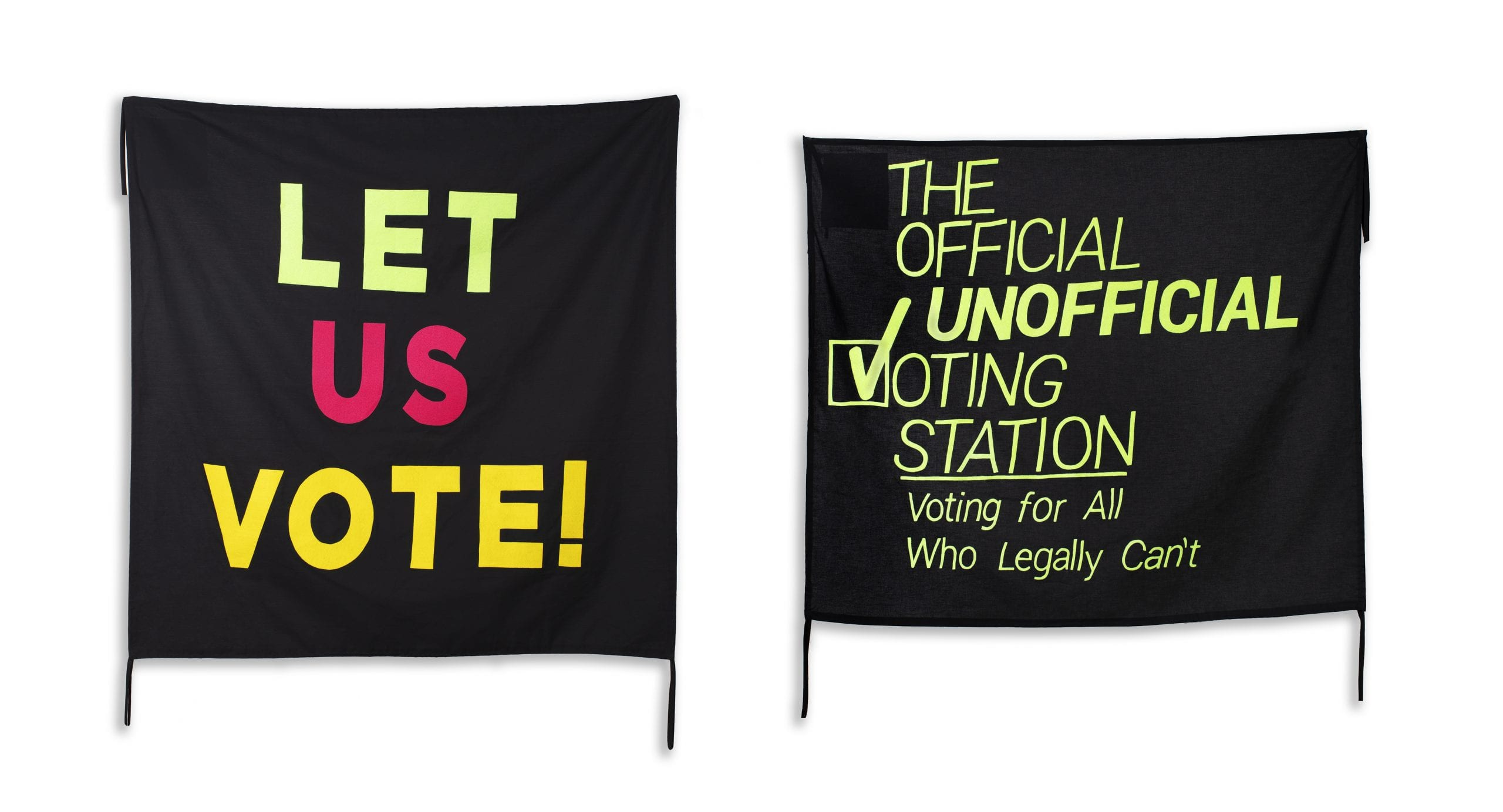 """One banner says """"Let Us Vote!"""" in bold, colorful neon letters on a black background; next to it, another banner says """"The Official Unofficial Voting Station: Voting for All Who Legally Can't"""" in neon green on black"""