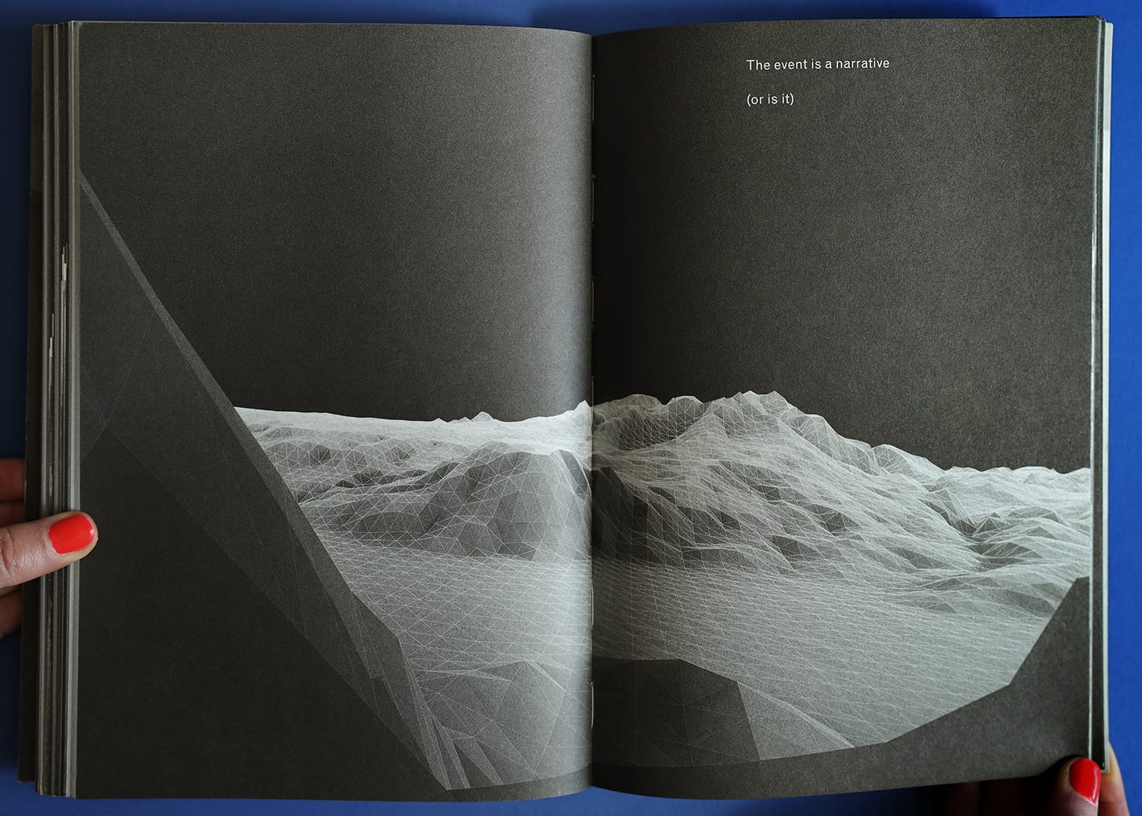 "Open-book spread of Imaginary Explosions, page 85. Above black-and-white graphic of mountain topography, text reads, ""The event is a narrative (or is it)"""