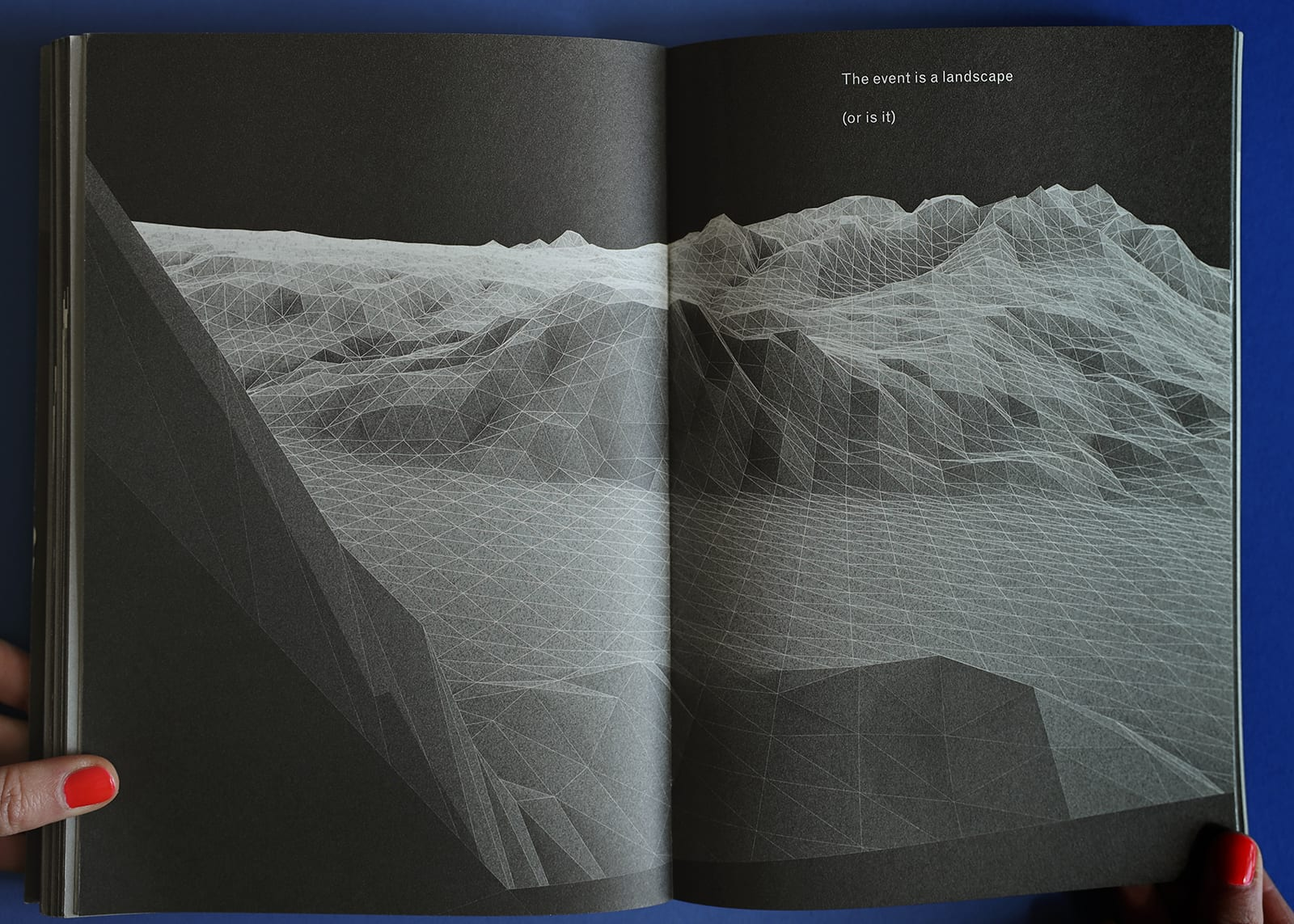 "Open-book spread of Imaginary Explosions, page 86. Above black-and-white graphic of mountain topography, text reads, ""The event is a landscape (or is it)"""