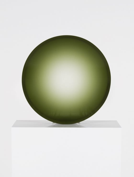 A Fred Eversley sculpture in the form of a green concave lens.